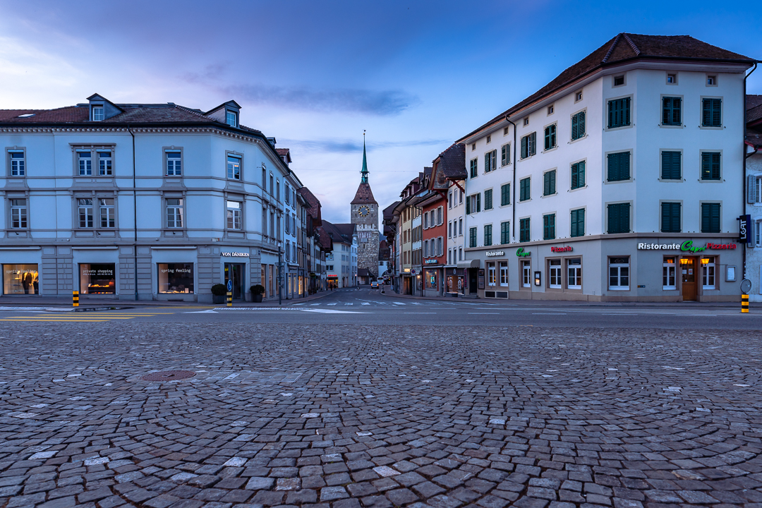 Early Evening in Aarau Downtown - Picture taken on early evening in Aarau city downtown, when the evening approached, it was getting dark, and the lights were just switched on. The city prepared for the evening and the night.